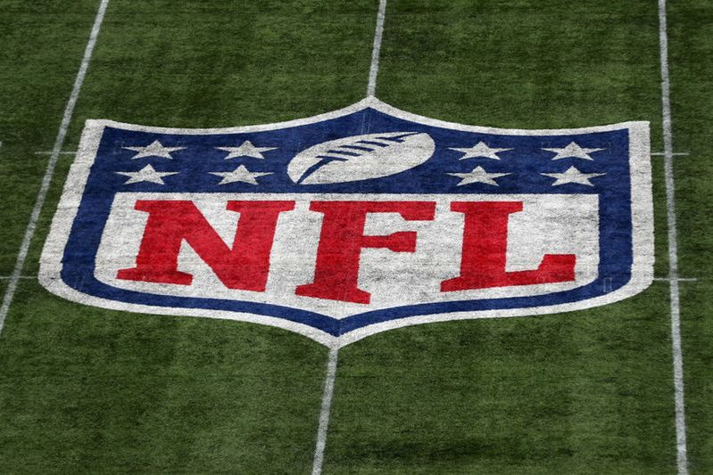 The NFL logo on a football field. The NFL is taking the right steps to fix diversity issues.